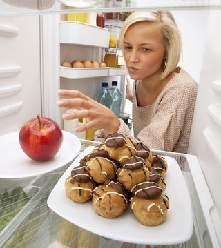 Girls faces temptation in the fridge