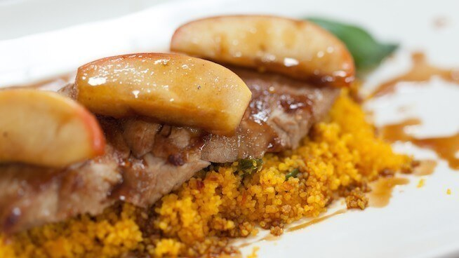 Close up of couscous with meat garnished with apple
