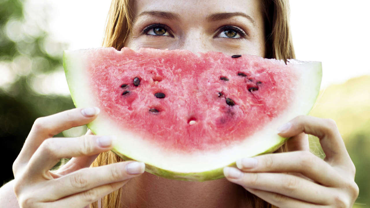 Woman with watermelon