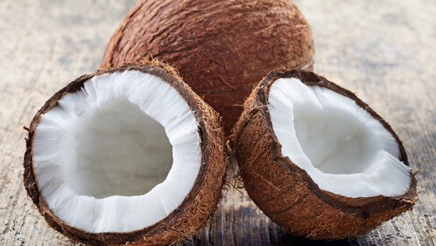 closeup of coconut on old wooden table