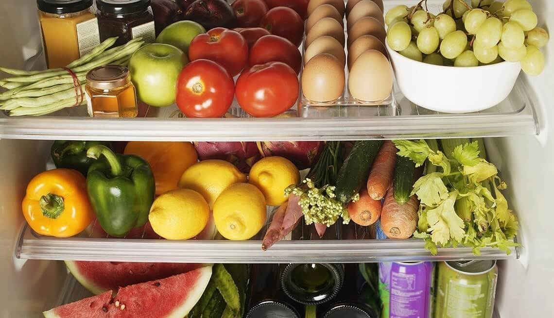 Packed Refrigerator Shelves --- Image by © Floresco Productions/Corbis